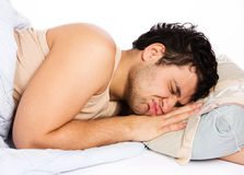 Man comfortably sleeping in his bed Royalty Free Stock Photo