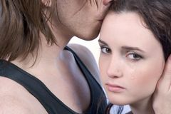 man comforting disappointed woman, show compassion Stock Image