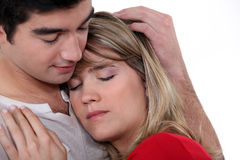 Man comforting  girlfriend Stock Photos
