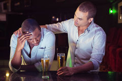 Man comforting his depressed friend Royalty Free Stock Photo