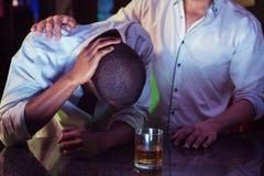 Man comforting his depressed friend Royalty Free Stock Image