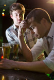 Man comforting his depressed friend Stock Image
