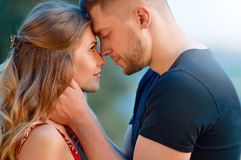 Man comforting his girlfriend embracing her in a park. True love among lovers. Sincere emotions and love on the planet Royalty Free Stock Image