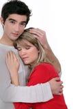 Man comforting his girlfriend. Stock Photo