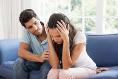 Man comforting his upset partner Stock Images