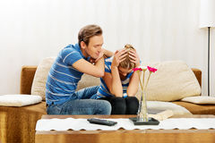 Man comforting his upset partner in living room Royalty Free Stock Photography
