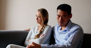Man comforting upset woman. At home stock video