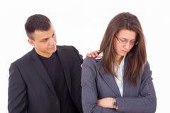Man comforting woman Stock Photos