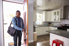 Man Coming Home From Work And Opening Door Of Apartment Stock Photography