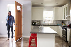 Man Coming Home From Work And Opening Door Of Apartment Royalty Free Stock Images