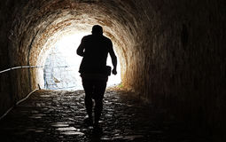 Man coming out of a dark tunnel Royalty Free Stock Images