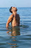 Man coming out of the water Royalty Free Stock Photography