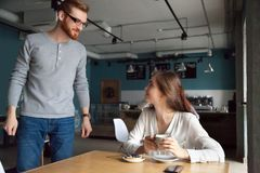 Free Man Coming To Cafe Table Getting Acquainted With Beautiful Woman Royalty Free Stock Photo - 117586865