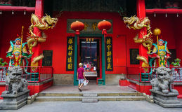 A man coming to the Chinese temple in Kuala Lumpur, Malaysia.  Royalty Free Stock Photos