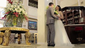 Man coming up to the bride and kissing her stock video footage