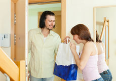 Man coming a woman with gift Stock Photography