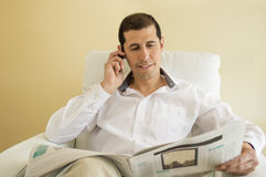 Man commenting economy news  by a cellphone Stock Images
