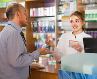 Man communicate with pharmacist Royalty Free Stock Photo