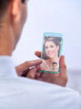 Man communicates with futuristic phone Royalty Free Stock Photography