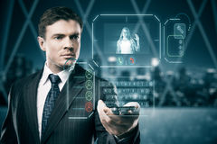 Man communicating with waving woman. Man in blurry interior communicating with young woman waving at him through abstract futuristic screen hologram. Concept of Royalty Free Stock Photos
