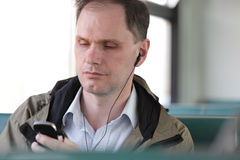 Man in commuter train Royalty Free Stock Images