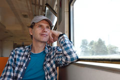 Man in a commuter train Royalty Free Stock Photos