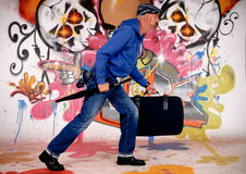 Man commuter, urban graffiti Stock Photos