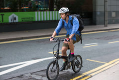 Man commuting to work by bike Stock Photography