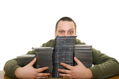 Man with compact disc. Man holding a pile of CD on the table Stock Photography