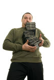 Man with compact disc. Man holding a pile of CDs on the table Stock Photography