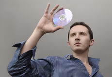 Man with compact disc. In hand Stock Images
