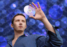 Man with compact disc Royalty Free Stock Images