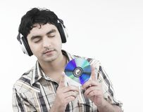 Man with a compact disc Stock Photos