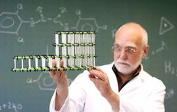 Man compares two molecular models Royalty Free Stock Photos
