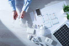 Man comparing an incandescent bulb and a CFL lamp Royalty Free Stock Photo