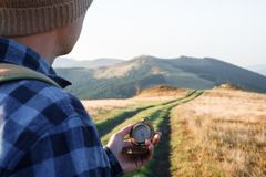 Man with compass in hand stock images