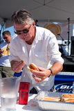 Man Competes In Hot Dog Eating Contest Royalty Free Stock Image