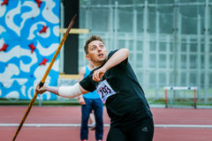 Man competes in the javelin throw. Chelyabinsk, Russia - June 10, 2015: A man athlete competing in the javelin throw during The universities championship of stock photo