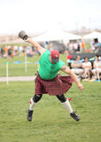 Man Competes in Weight Toss Stock Photography