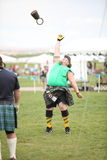 Man Competes in Weight Toss stock image
