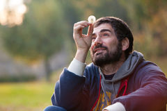 Man completely in love. Lost in mind. Harmony hope and nature. Man in nature. Harmony and romance. A bearded man holding a dandelion flower in a natural park. He royalty free stock image