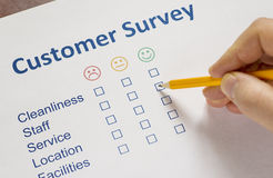 Man completing a customer survey Royalty Free Stock Photos