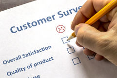 Man completing a customer survey Royalty Free Stock Photo