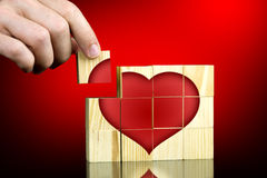 Man completing a red romantic heart shape Royalty Free Stock Image
