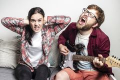 Free Man Composer Plays A Six-string Electric Guitar And Loudly Sings A Song Of His Own Composition, His Girlfriend Does Not Like This Stock Image - 163328391