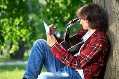 Man composing song Stock Images
