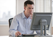 Man on Computer Stock Photography