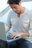 Man with computer Stock Photography