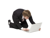 Man with a computer. Man on the floor with a computer Royalty Free Stock Images