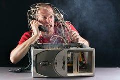 Man and computer burning Royalty Free Stock Photos